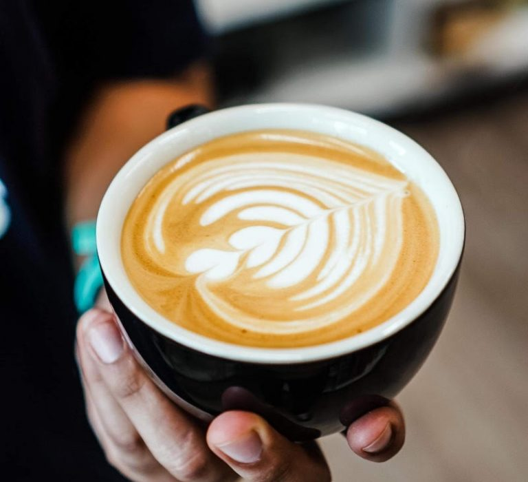 holding espresso